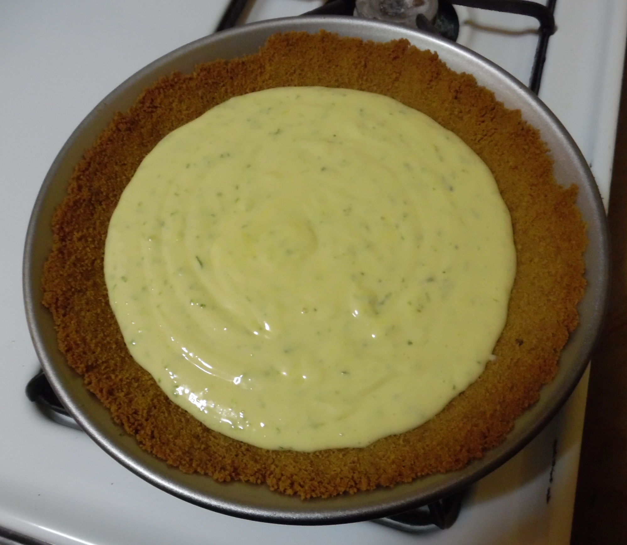 Filling, poured into prebaked crust.
