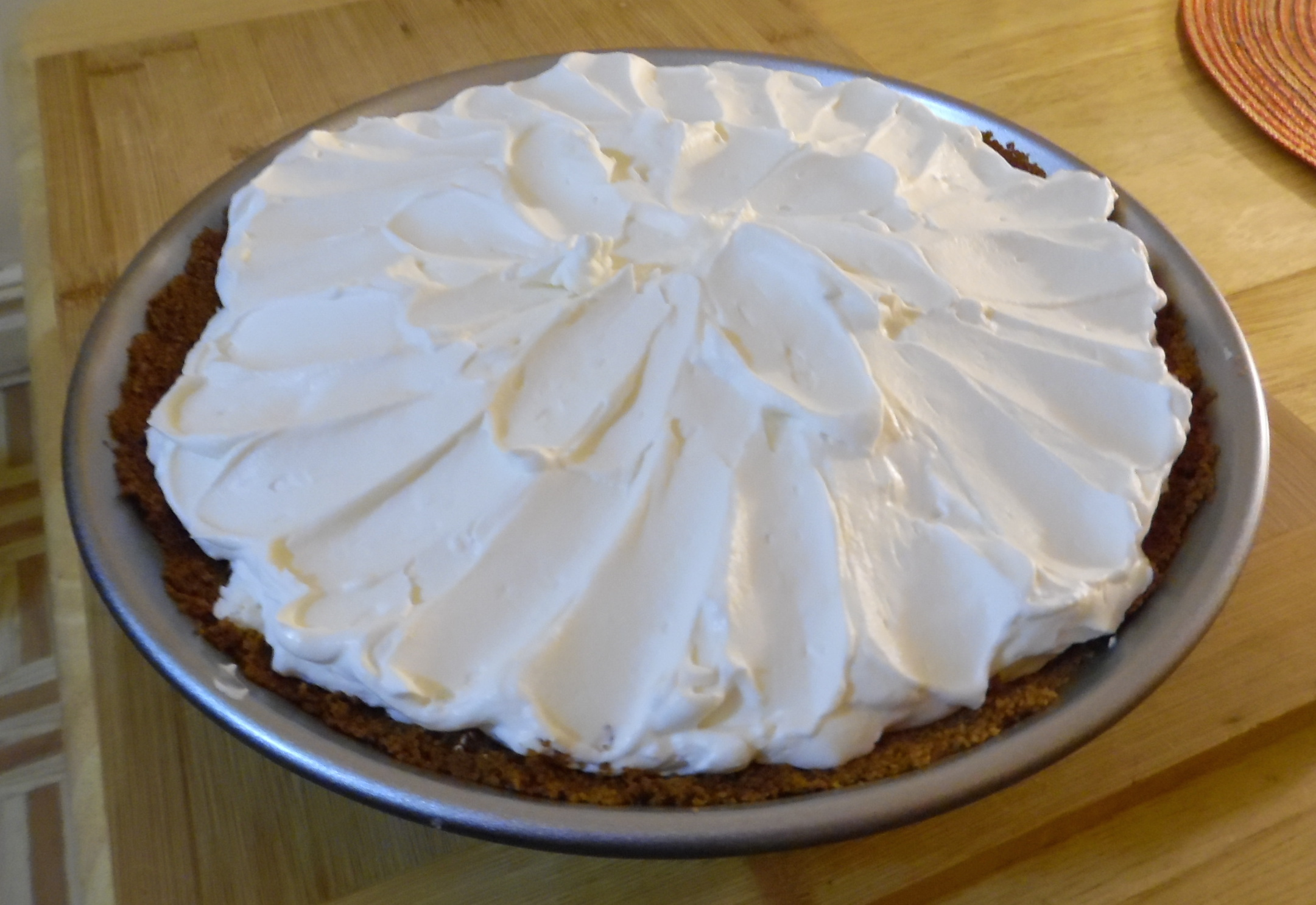 Topping spread over filled and cooled pie.